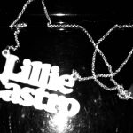 plastic pendant that spells out the name Lillie Castro